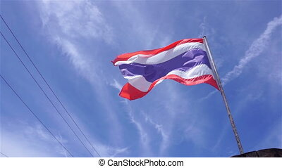 Thai flag at boat on sunny day