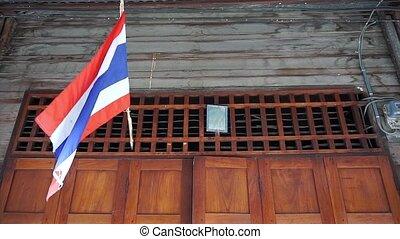 Thai flag hanging above door home