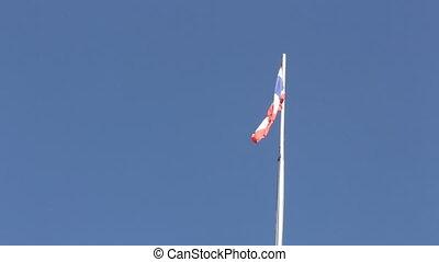 Thai flag of Thailand waving on blue sky