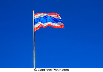 Thai flag of Thailand with blue sky background.