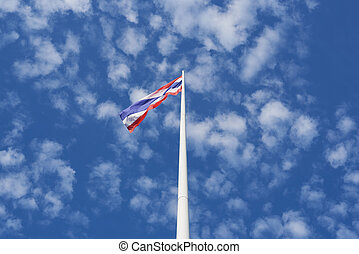 Thai flag waving on blue sky background