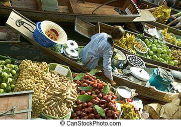 Thai Floating Market - Thai women in boat admist fruit on ...