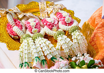 thai flower garlands on a tray with pedestal