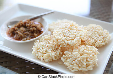 Thai food rice crust with pork spicy sauce