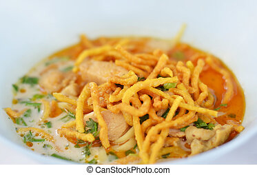 Thai food - A noodle dish in a yellow curry with chicken....