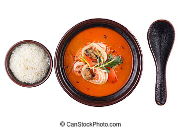 Thai Food Tom Yum Gong. Soup in a black bowl isolated on white background.