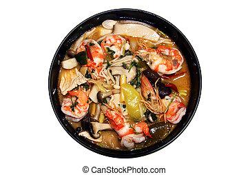 Thai food Tomyum shrimp with lemon on white background