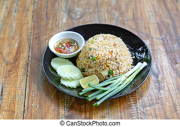 Thai fried rice on wooden desk