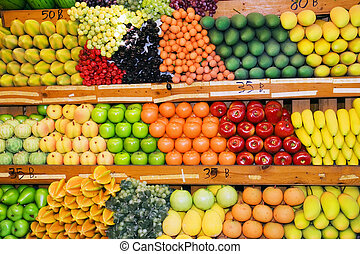 Thai Fruit Stand - Variety of fruits and vegetables at fruit...