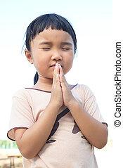 Thai girl praying and close her eye for something