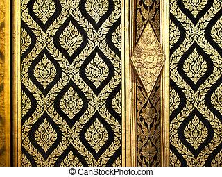 Thai gold art on wood door