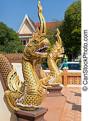 Thai golden dragon guards the entrance to the temple