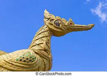 Thai Golden Swan on Blue Sky Background
