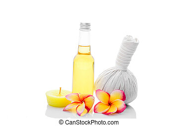 Thai herbal massage ball and oil bottle, isolated on white.