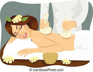 Thai herbal poultice massage - young woma lying on a spa bed