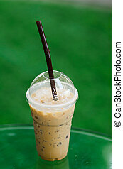 Thai ice coffee with green background.