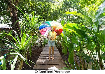Thai lady standing with umbrella