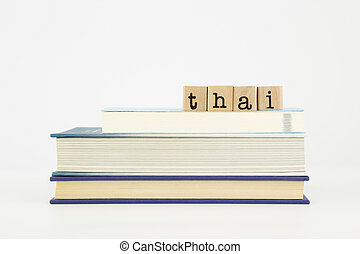 thai language word on wood stamps and books