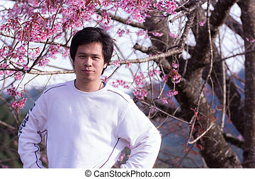 Thai man with Wild Himalayan Cherry, portrait