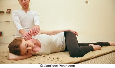 Thai massage - caucasian model female - stretch the muscles,...