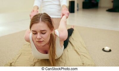 Thai massage for young woman - the treatment of the spine,...