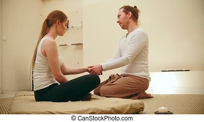 Thai massage session - flexing the elbows and forearms for blonde girl model, slider, wide angle
