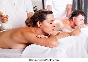Thai massage - man and woman having Thai massage