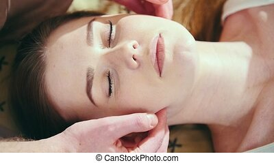 Thai massage treatment for head and face - white young...