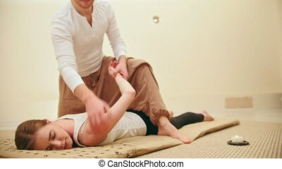 Thai massage - woman gets Thai traditional therapy for...