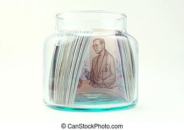 Thai money in the glass bottle