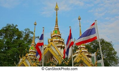 Thai National Flags Superimposed over a Buddhist Temple in...