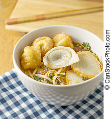 Thai Noodle tomyum soup with fish ball