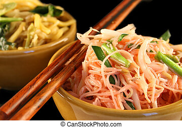 Thai Noodles - Thai style fried noodles in a bowl on a black...