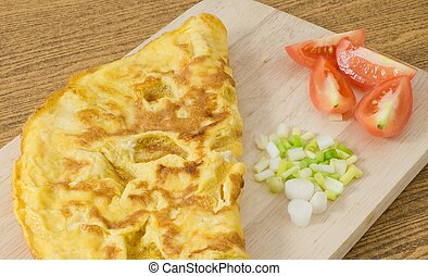 Thai Omelet with Tomatoes and Scallion on Cutting Board