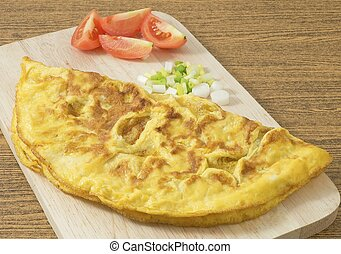 Thai Omelette with Tomatoes and Scallion on Wooden Board