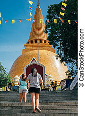 Thai pagoda with two women walking upstair