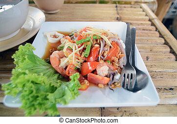 Papaya Salad hot and spicy, mixed vegetable and seafood.