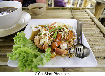 Thai Papaya Salad hot and spicy with seafood.