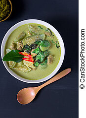 Thai prok green curry on black background