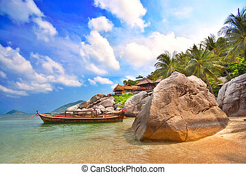 Thai resort - Long tailed boat in a Thai bay