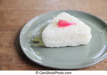 Thai rice on wood background