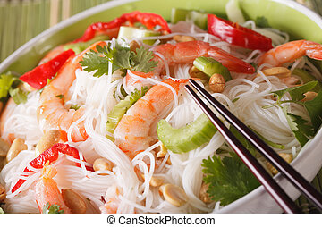 Thai salad with glass noodles, prawns and vegetables macro. Horizontal