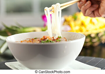 Thai Soup with Pork - Closeup of a person eating Thai style ...