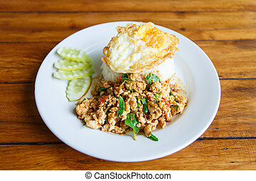 Thai spicy food basil chicken fried rice recipe with fried egg (