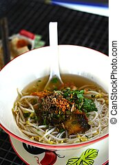 Thai street food fish noodle - A dish of noodle soup with...