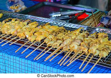 Thai street food - Grilled squid at street food...