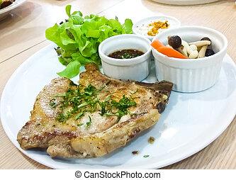 Thai style pork steak served with spicy sauce