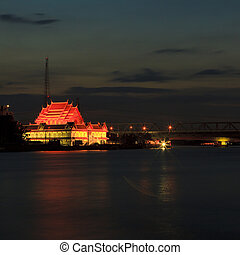 Thai temple at night from Chao Phraya River