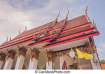 Thai temple in Phuket Town Wat Mongkolnimit.