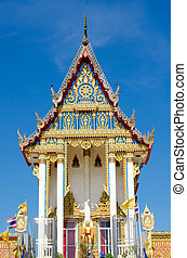 Thai temple on the blue sky background